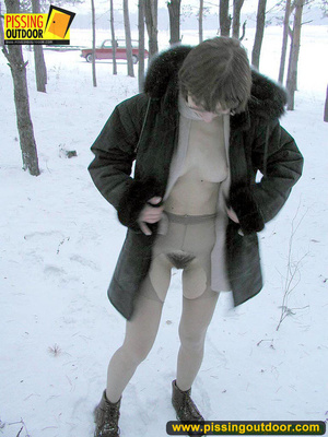 Kinky teen in glass bends to piss in the snow revealing tits and cute bushy pussy - XXXonXXX - Pic 3