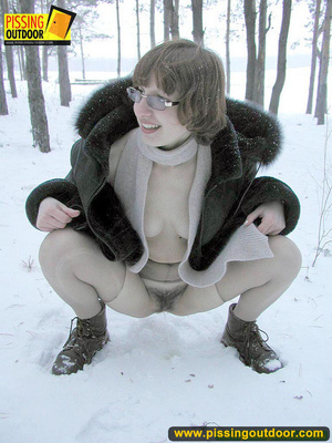 Kinky teen in glass bends to piss in the snow revealing tits and cute bushy pussy - XXXonXXX - Pic 7