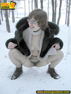 Kinky teen in glass bends to piss in the snow revealing tits and cute bushy pussy - XXXonXXX - Pic 9