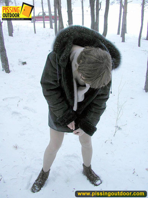Kinky teen in glass bends to piss in the snow revealing tits and cute bushy pussy - XXXonXXX - Pic 18