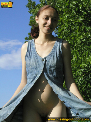 Young chick removes panties and stands pissing outdoors before tasting her cunt - XXXonXXX - Pic 3