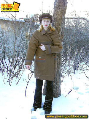 Blonde teen wearing only a coat in winter opens it to stand pissing on the snow - XXXonXXX - Pic 1