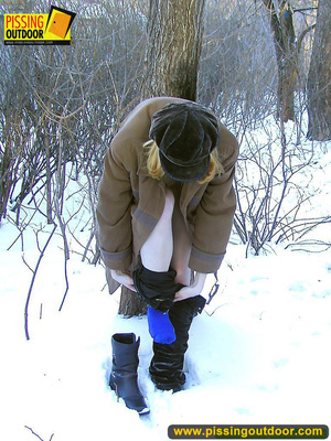 Blonde teen wearing only a coat in winter opens it to stand pissing on the snow - XXXonXXX - Pic 6