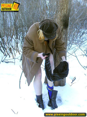 Blonde teen wearing only a coat in winter opens it to stand pissing on the snow - XXXonXXX - Pic 7