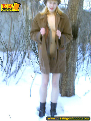 Blonde teen wearing only a coat in winter opens it to stand pissing on the snow - XXXonXXX - Pic 8