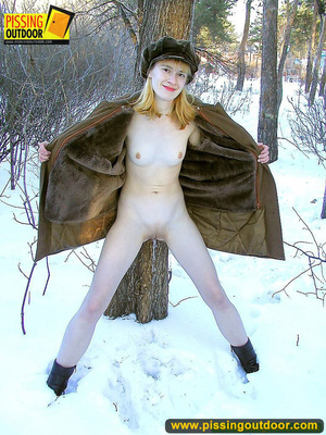 Blonde teen wearing only a coat in winter opens it to stand pissing on the snow - XXXonXXX - Pic 12
