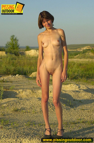 Nude brunette with slim sexy shape opens up pussy lips to stand pissing outdoors - XXXonXXX - Pic 1