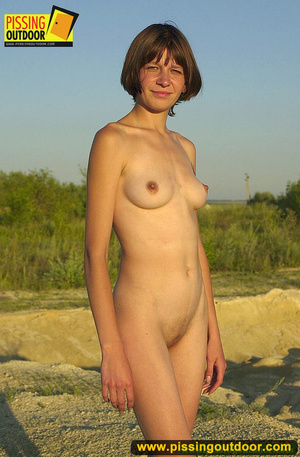 Nude brunette with slim sexy shape opens up pussy lips to stand pissing outdoors - XXXonXXX - Pic 2
