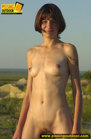 Nude brunette with slim sexy shape opens up pussy lips to stand pissing outdoors - XXXonXXX - Pic 4