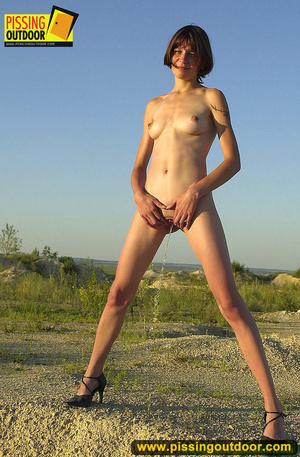 Nude brunette with slim sexy shape opens up pussy lips to stand pissing outdoors - XXXonXXX - Pic 13