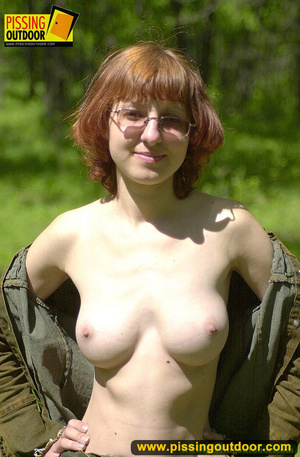 Cute red head in glasses gets nude and sits down on grasses to jet out hot piss - XXXonXXX - Pic 3