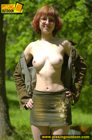 Cute red head in glasses gets nude and sits down on grasses to jet out hot piss - XXXonXXX - Pic 4