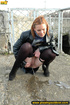 Girl in leather and stockings taking a stroll stops to piss outdoors in