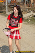 Hot girl in red raises short red skirt to piss hot piss on public road