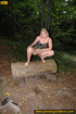 Horny blonde in cute short skirt takes walk in woods and pisses on tree