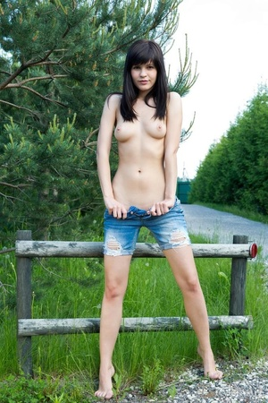 Brunette teeny takes off her jeans short - XXX Dessert - Picture 1