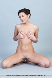 lovely brunette strips her