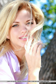 blonde model strips erotically