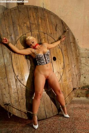 Sexy corset wearing blonde sex-slave get - XXX Dessert - Picture 1