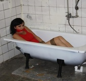 Nasty brunette gets tied and left in an old bathtub
