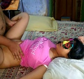 Busty Indian slut in a mask and pink T-shirt enjoys good fucking