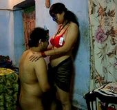 Slutty Indian chick in a mask and red bra spreads her legs for a prick
