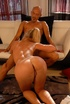 Wild tattooed blonde loves getting her juicy pussy penetrated on a sofa.