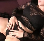 Dark haired hairy beauty Brook Scott is lounging around in a lacy black