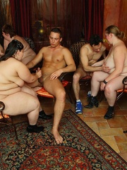 She gives a blowjob as the BBW orgy goes on around her - Picture 1