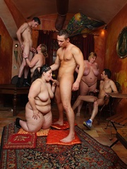 She gives a blowjob as the BBW orgy goes on around her - Picture 4