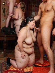 She gives a blowjob as the BBW orgy goes on around her - Picture 5