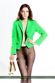 green top wearing brunette