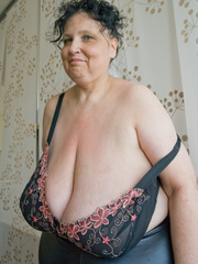 Curly brunette mature demonstrates her enormous boobs - Picture 5