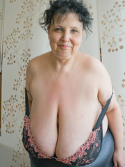 Curly brunette mature demonstrates her enormous boobs - Picture 10