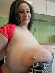 Brunette MILF in pink shorts and T-shirt flaunting - Picture 13