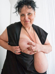 Curly brunette mature playing with her giant titties - Picture 3