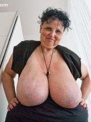 Curly brunette mature playing with her giant titties - Picture 4