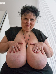 Curly brunette mature playing with her giant titties - Picture 5