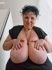 Curly brunette mature playing with her giant titties - Picture 6