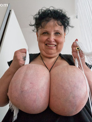 Curly brunette mature playing with her giant titties - Picture 8