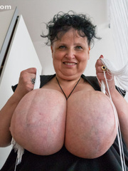 Curly brunette mature playing with her giant titties - Picture 9