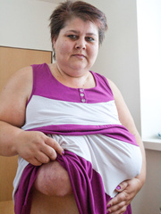 Old fat slut with gigantomastia gets naked - Picture 6