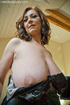 Horny milf with huge juggs in the evening dress gets topless