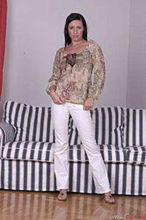 Brunette MILF undresses to present her f - XXX Dessert - Picture 1