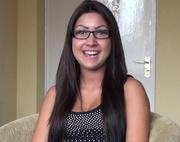 smiling brunette glasses ready