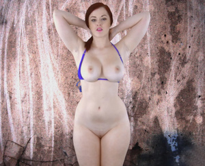 Curvy redhead with lusciously big tits a - Picture 4