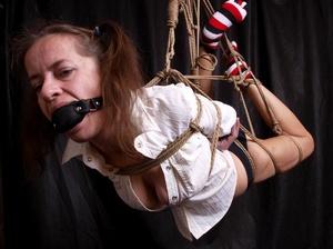 Lusty gag wearing brunette milf hanging  - XXX Dessert - Picture 1
