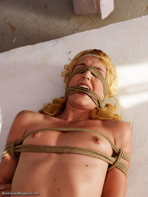 Hot blonde girl bound and folded with ro - Picture 8