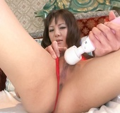 Kinky fun loving Asian babe uses big vibrator to get her hairy pussy to