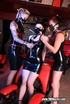 Three dykes in masks with spikes having dirty fun